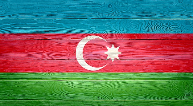 Azerbaijan flag painted on old wood plank background