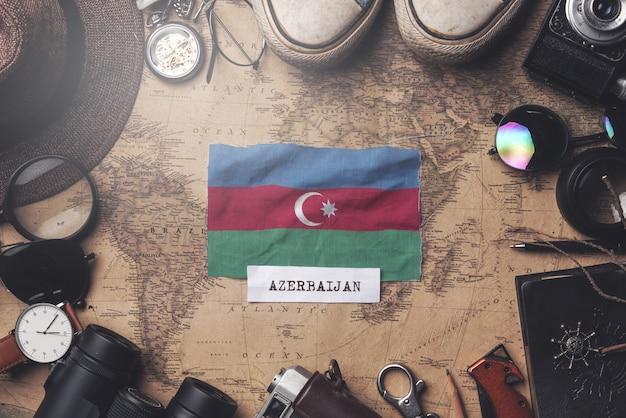 Azerbaijan flag between traveler's accessories on old vintage map. overhead shot