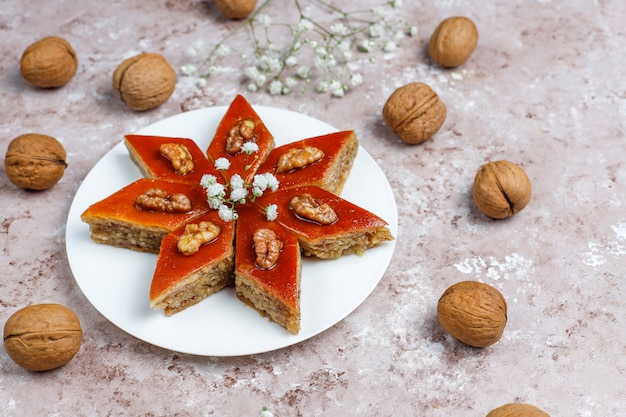Azerbaijan national pastry pakhlava on white plate  ,top view,spring new year celebration novruz holiday.
