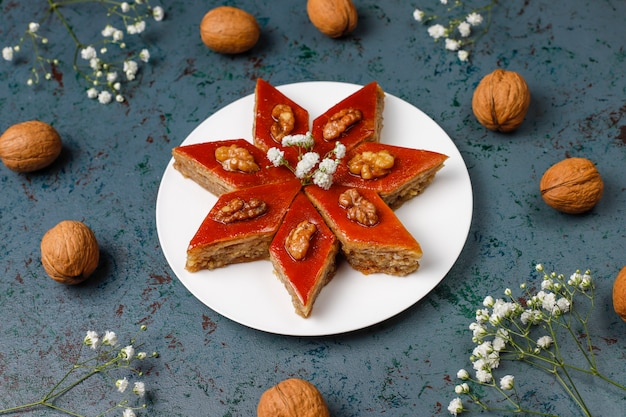 Azerbaijan national pastry pakhlava on white plate  ,top view,spring new year celebration novruz holiday.