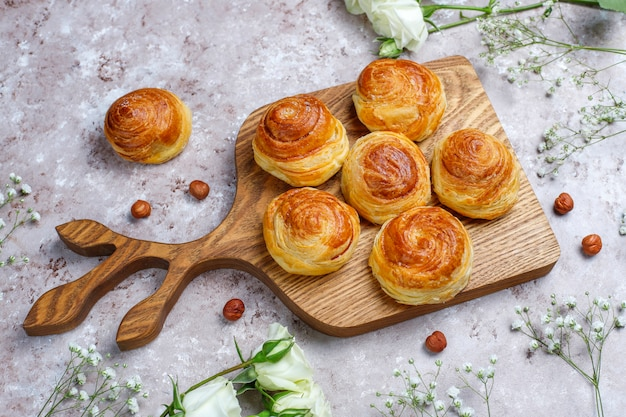 Azerbaijan national pastry qogal on white plate  ,top view,spring new year celebration novruz holiday.