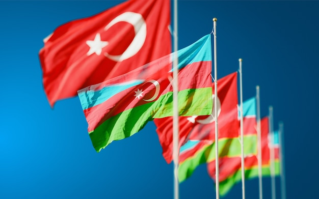Azerbaijan and turkey flags waving in the sky