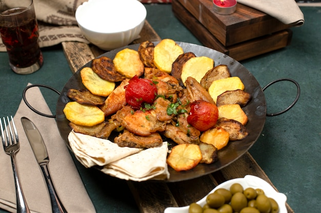 Azerbaijani dish with lavash and grilled foods