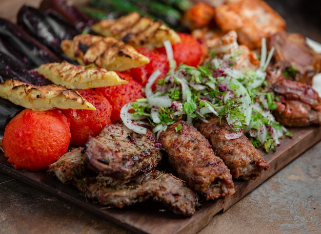 Azerbaijani lyulya kebab with potatoes and vegetables