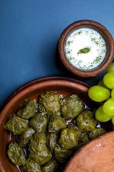 Azerbaijani stuffed grape leaves dolma served with yogurt