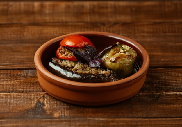 Azerbaijani three veegtable olma, stuffed with meat and herbs