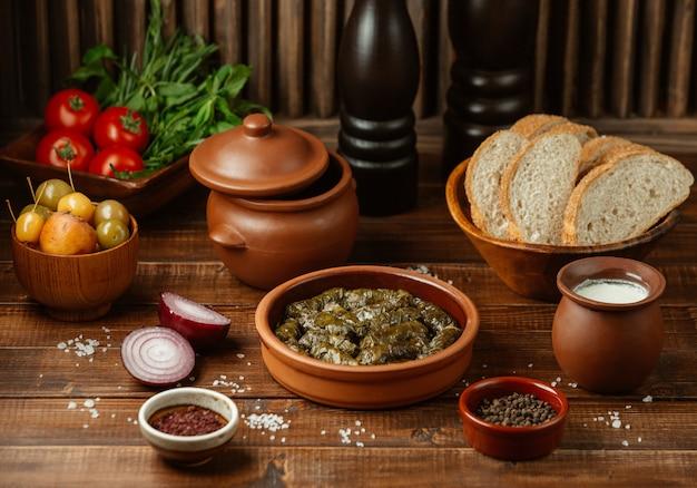 Azerbaijani yarpaq dolmasi, grape leaves stuffed with meat herb mix