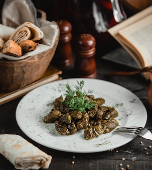 Azeri dolma from grape leaves