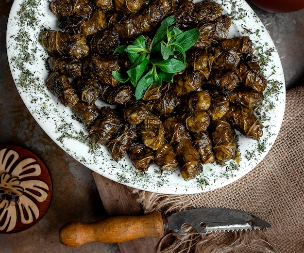 Azeri national dolma from grape leaves