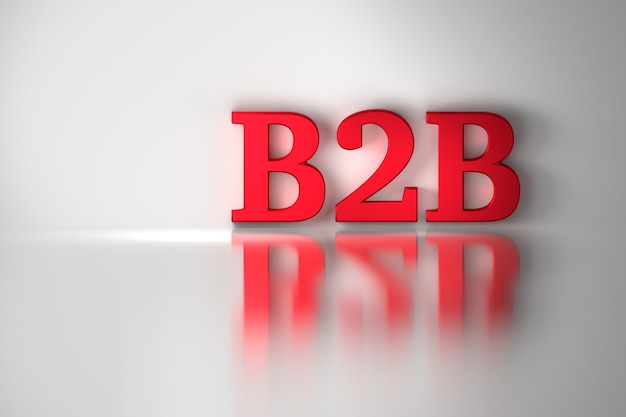B2b business to business text red letters on shiny reflective white surface.