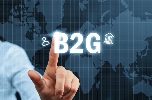 B2g concept. business to government on abstract graphic display with world map