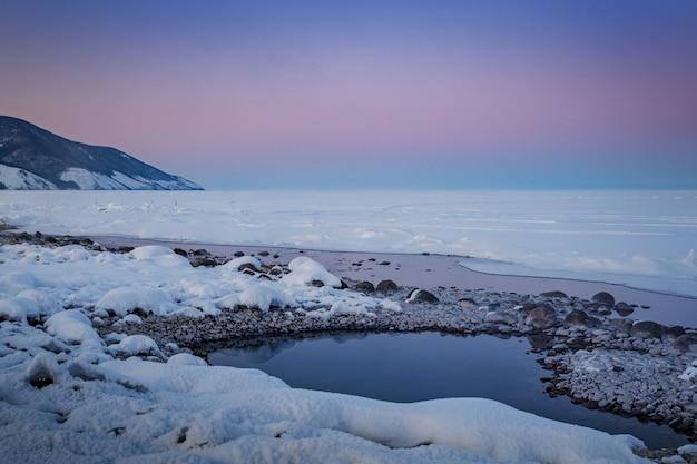 Baãƒâƒã'â¯kal lake by winter, sibãƒâƒã'â©rie, russie.