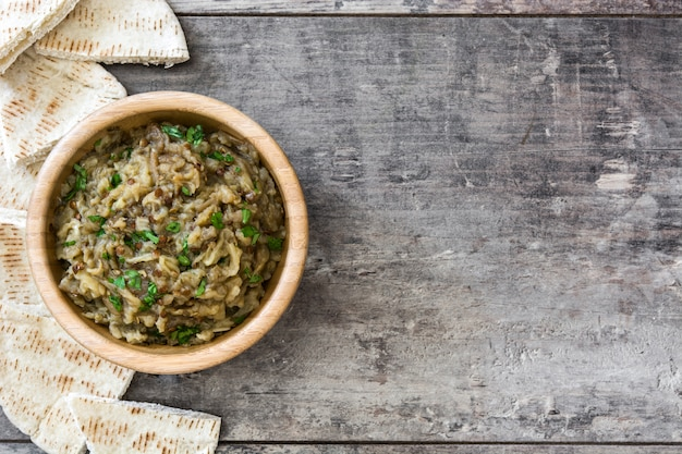 Baba ganoush in bowl on wooden table