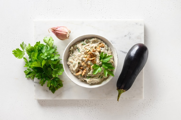 Baba ganoush from baked eggplant with parsley garlic view from above