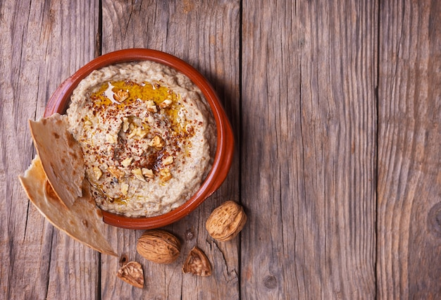 Baba ganoush from baked eggplant with sesame paste and pieces of lavash with walnuts