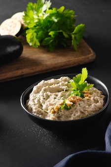 Baba ganoush levantine cuisine appetizer from baked eggplant with parsley garlic and olive oil close