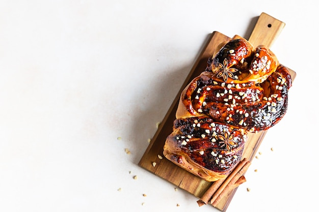 Babka or brioche bread with apricot jam and nuts. homemade pastry for breakfast. top view.