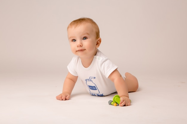Baby 8 months on white background