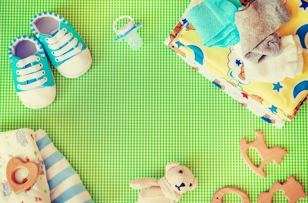 Baby accessories for newborns on a colored background.