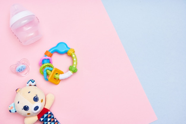 Baby accessories on pink and blue background. flat lay . top view copy space.
