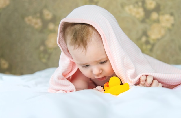 Baby after bathing in a towel