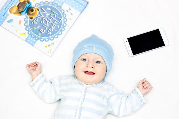 Baby among books with spectackles