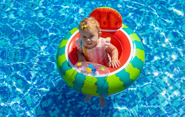 Baby bathes in a circle in the pool. selective focus. child.