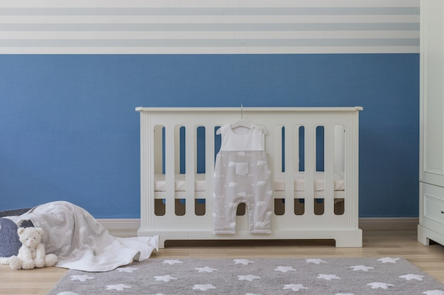Baby bedroom with white teddy bear