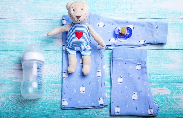 Baby body clothes on light