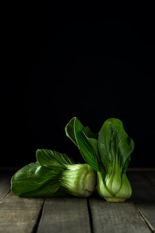 Baby bok choi on wooden rustic table