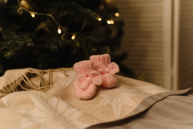 Baby booties on new year background.