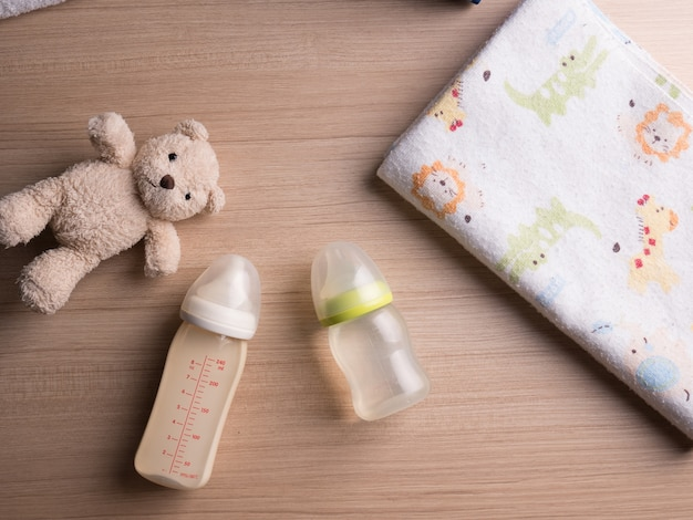 Baby bottle with milk and a measuring scale