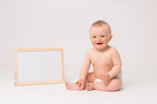 Baby boy in diapers on white background