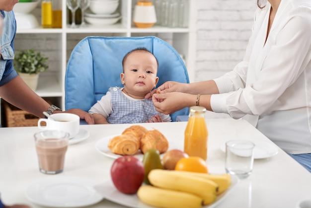 Baby boy joining family dinner