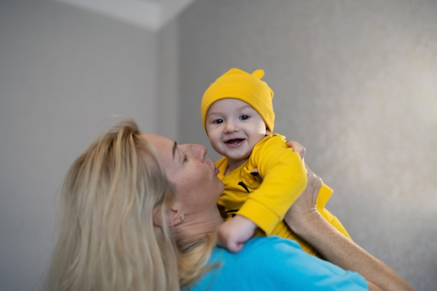 Baby boy playing with his mom at home, lifestyle