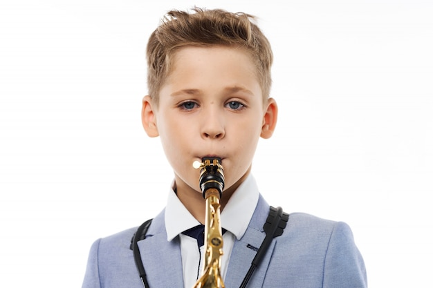 Baby boy plays the saxophone