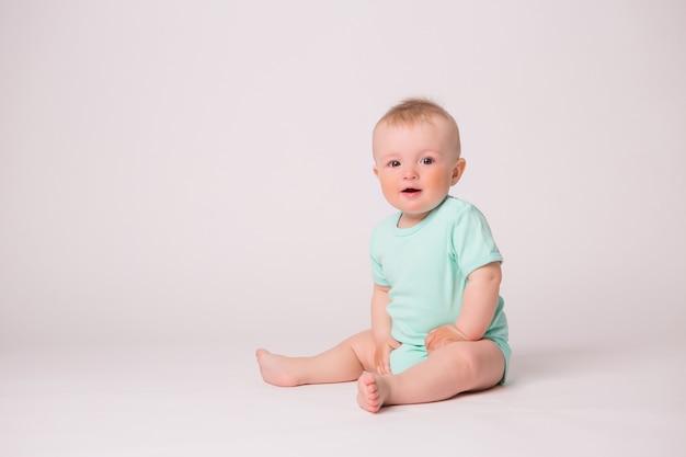 Baby boy smiling on white