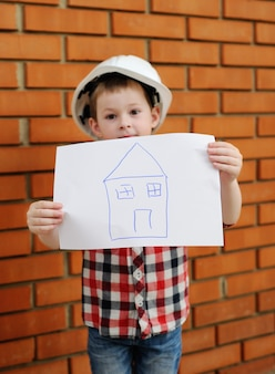 Baby boy in white construction helmet