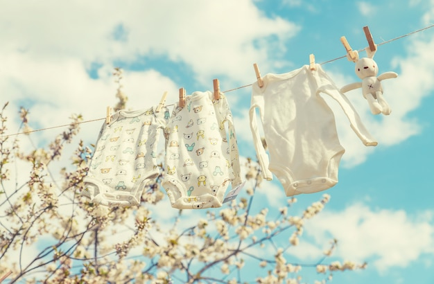 Baby clothes are drying on the street. selective focus.