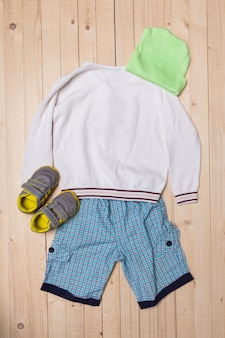 Baby clothes for boys on wooden