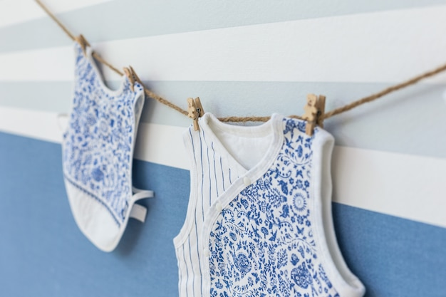 Baby clothes hanging on rope