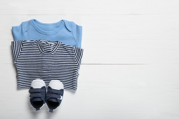 Baby clothes on a white background. place for text