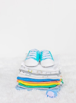 Baby clothes on a white