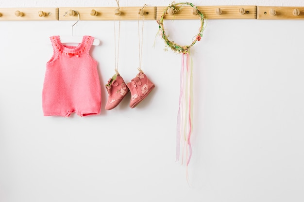 Baby clothes and wreath