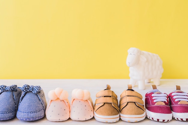 Baby concept with four different pairs of shoes