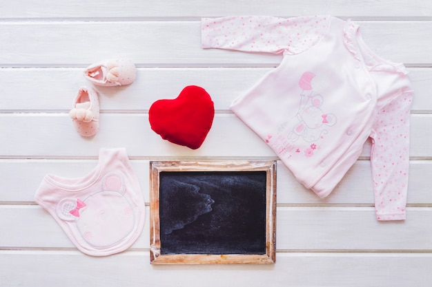 Baby concept with slate and heart