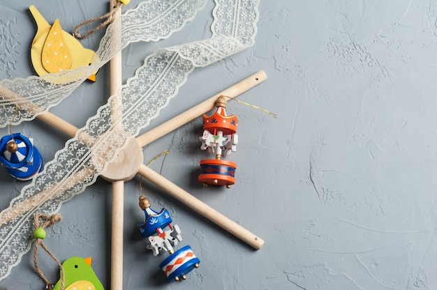 Baby crib mobile with wooden colorful birds