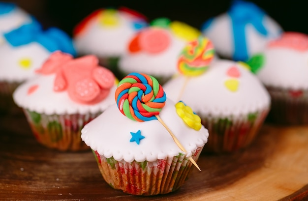 Baby cupcakes on wood