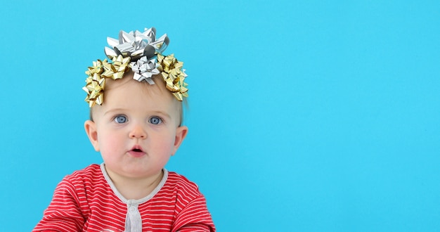 Baby decorated with a bow as a gift
