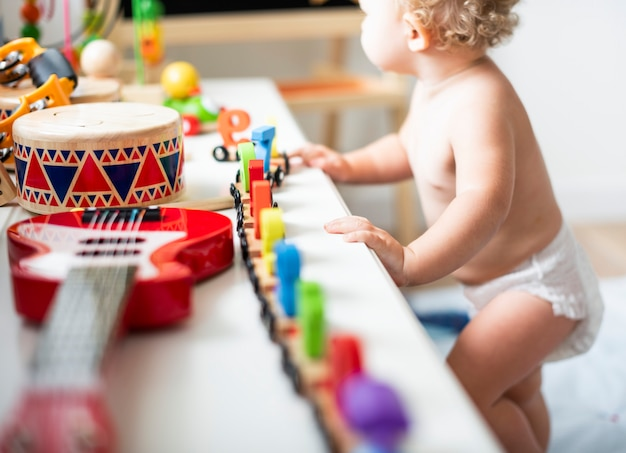 Baby in a diaper in a play room